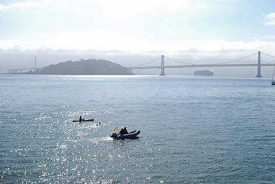 A couple of swimmers heading toward the Bay Bridge