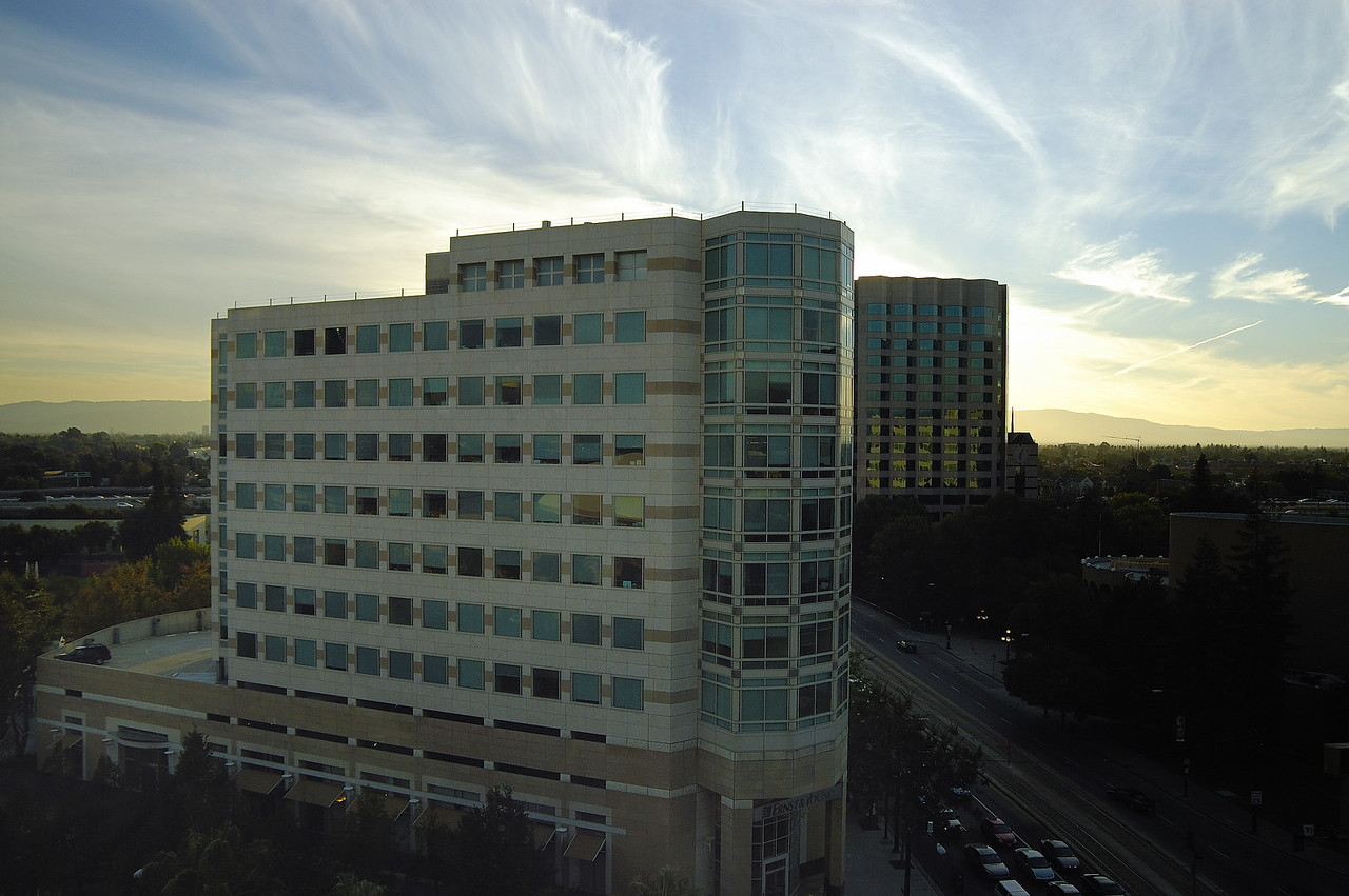 Sunset at Ernst & Young<br /> <br /> Downtown San Jose. Looking out my hotel room window at the Hilton.