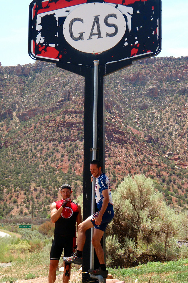 Day 5 Alex and Andrew Under the Gas Sign (couldn't be more appropriate)