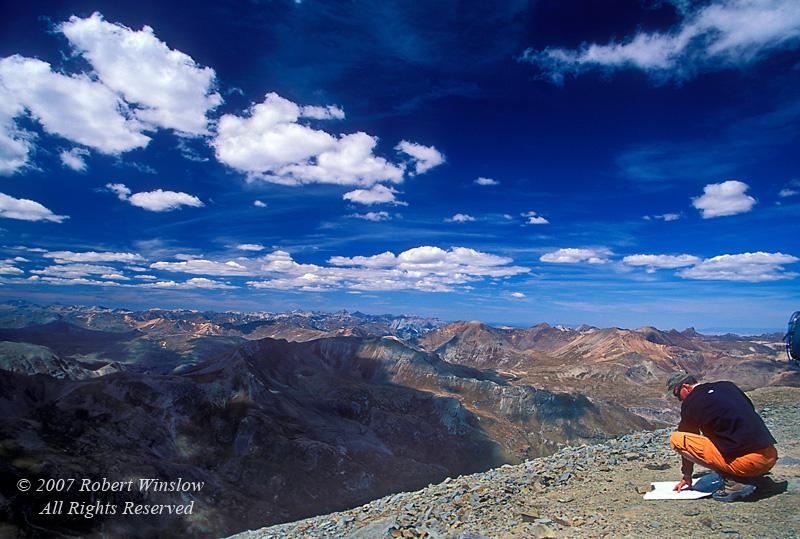 NoMR, Person Looking at a Map on Handies Peak (14,048 feet) San Juan Mountains, Colorado