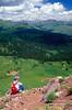 Male Hiker Sitting, Resting, Admiring the View.  San Juan Mountains, San Juan National Forest, Near Durango, Colorado