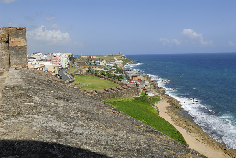 In the distance, you can see the lighthouse over El Morro.  I walked along the road up to the castle in about 90 degree heat
