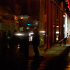 """<span id=""""title"""">Street Scene</span> Most of this photo is a reflection off a shiny wall."""