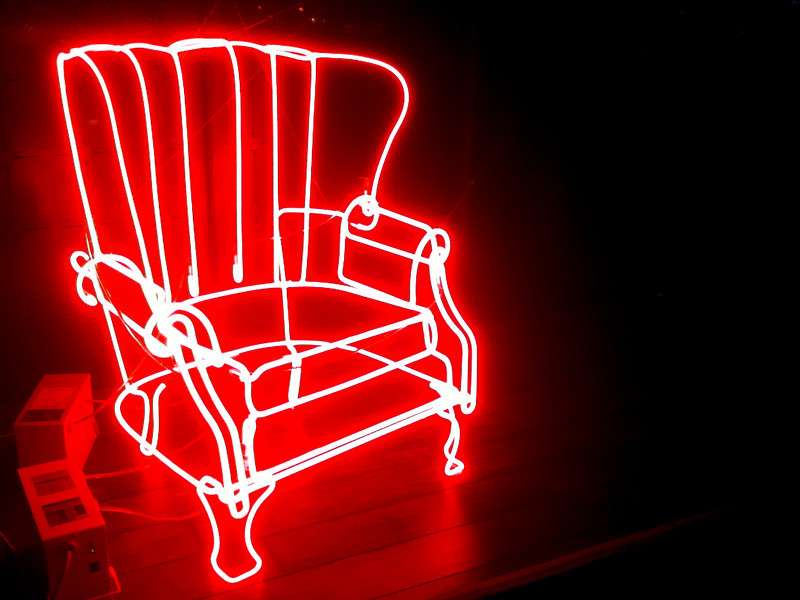"""<span id=""""title"""">Neon Chair</span> This awesome chair was sitting in a window near a restaurant we went to. Get it? """"Sitting""""?! No? Ok, sorry."""