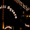 """<span id=""""title"""">Ghirardelli Square</span> Sure, it's Ghirardelli Square, but how are you supposed to know that? Someone should put up a sign. BTW, I know from a previous SF trip that the large sign above the buildings is clearly legible from Alcatraz."""