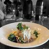Halibut ceviche tostada, cherry tomato, avocado--with cilantro.