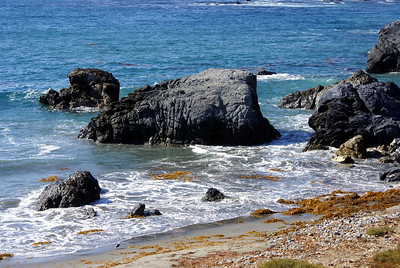 Shark Harbor - named for a rock that looks like a shark's fin or a tooth....