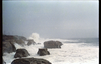 Waves break against the rocks on West Cliff Drive, reaching 50 vertical feet above the surf line