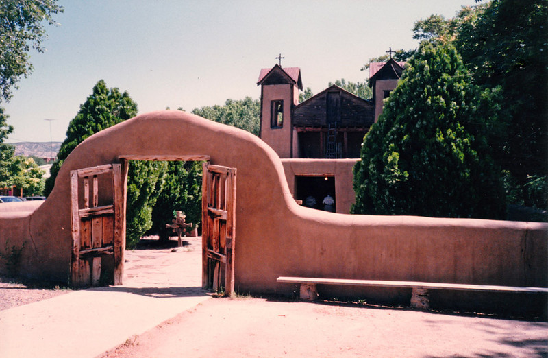 "EL SANTUARIO DE CHIMAYO<br /> Chimayo, New Mexico<br /> <br /> Known widely as the ""Lourdes of America."" The soil at El Santuario as well as at other sites in the area was believed to produce a mud that, when eaten or applied to the skin, had miraculous healing powers. The crippled, blind, and those afflicted with other diseases came to be cured when all other treatments failed."