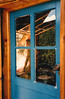 THROUGH THE BLUE DOOR<br /> In typical Southwest fashion, Paige has the door to his cabin painted blue to ward off evil spirits, who are supposed to think that the blue is heaven and therefore won't want to enter.