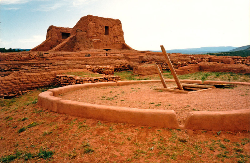 KIVA AND PECOS MISSION RUINS<br /> Pecos, New Mexico<br /> <br /> Archeologists now believe this kiva near the mission may have been concurrent with the second grand church. (The remains of that church and two reconstructed kivas and may be visited at Pecos National Historical Park.)