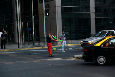 Juggling for cash at traffic stop beats wiping down windshields. Santiago, Chile