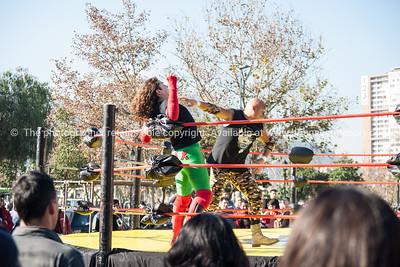 Wrestling exhibition outside Santiago's Mercado Central.