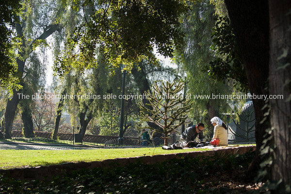 Couple relax in grounds of Castillo Hildago on Cerro Santa Lucia.