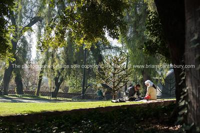 Couple relax in grounds of Castillo Hildago on Cerro Santa Lucia.