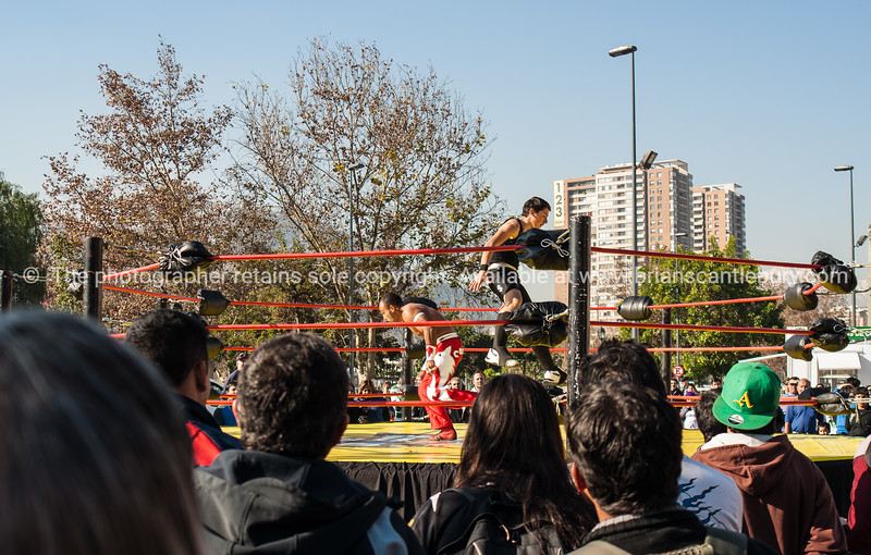 Wrestling exhibition outside Santiago's Mercado Central. a major fish and meat market, and tourist attraction.