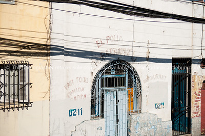 Faded signage of a Santiago takeaway.