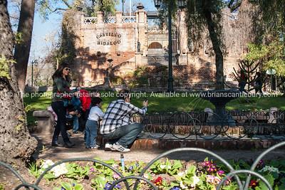 Street scenes and buildings.Santiago de Chile. Family photograph around the fountain, Castillo Hildago.
