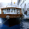 A local boat awaits to board cruise ship passengers to take them to the old port and visit the Fira town in the island of Santorini, Greece.
