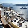 A view of the cliffside community and building architectures at the town of Fira on the island of Santorini, Greece.