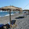 Black sand beach at Kamari Village on the island of Santorini, Greece.
