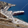 A ferry boat docks at the new Athinios port on the island of Santorini, Greece.
