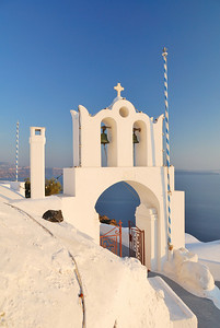Archway to a small church in the late afternoon on the outskirts of Oia