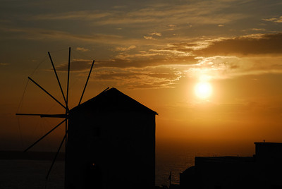 Windmill at sunset in the village of Oia