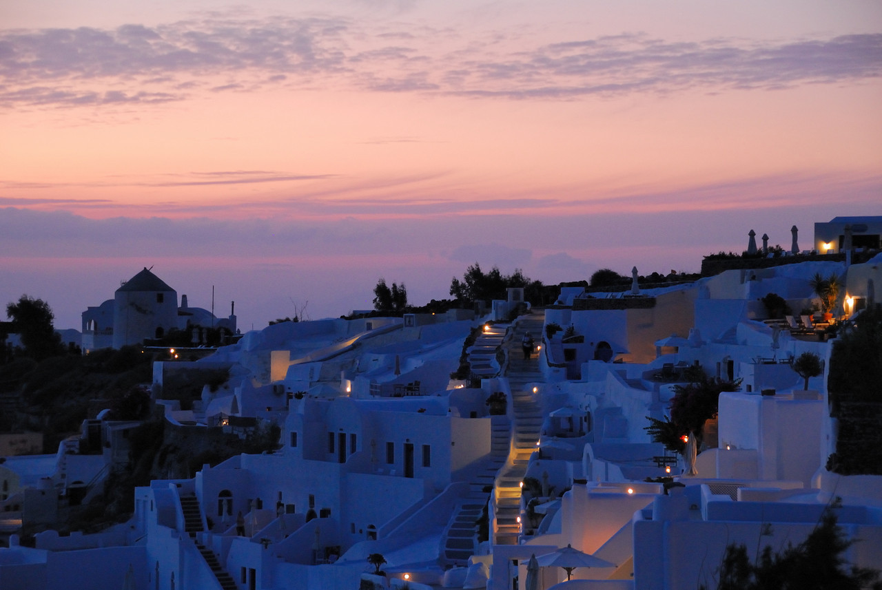 Santorini traditional houses on the outskirts of Oia at dusk