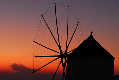 Silouette of a windmill in the village of Oia, Santorini