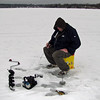 "This is one of the many individual ice fishermen out on frozen area lakes and rivers.  The auger is used to bore a small hole through the ice.  This man told me the average thickness of the lake ice was about 8"" thick.  He told me that thickness would easily support the weight of a man and even the weight of a man on a 4-wheeler all across the lake."