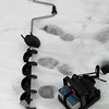 Closeup of the ice auger.  The other device in lower right is a fish finder.