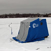 Some ice fishermen build huts, others just put up tents.  Either way, you're fishing protected a bit from the elements.