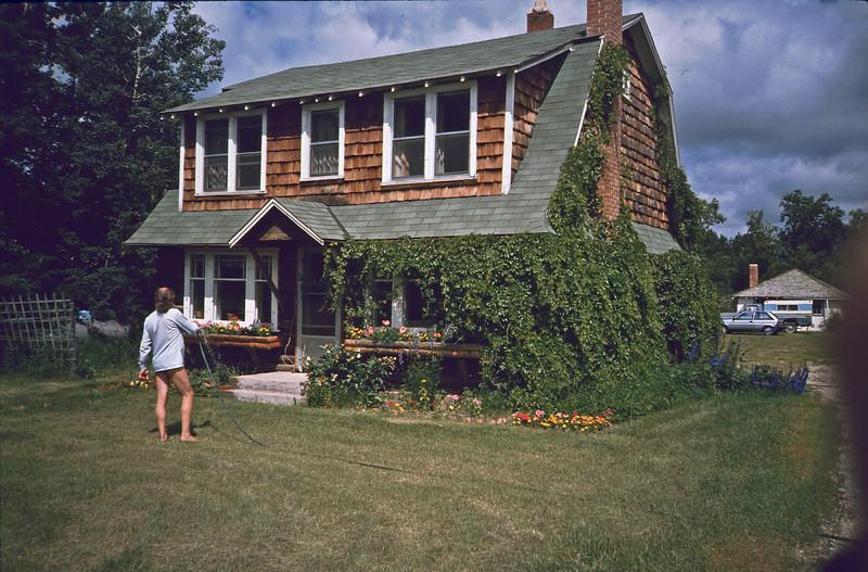 Myles MacDonald watering, Spruce Home, Sask.