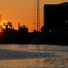 Sunrise on the Savannah River, with the sun coming up over the tug boats