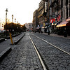 Early morning on River street in Savannah GA with railroad tracs and cobblestone before the crowds come!