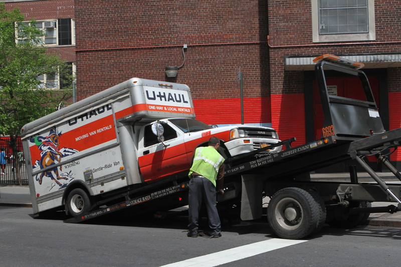 An unattended U Haul in New York means tow now and straighten out the details later.  Talk about a bad moving day.