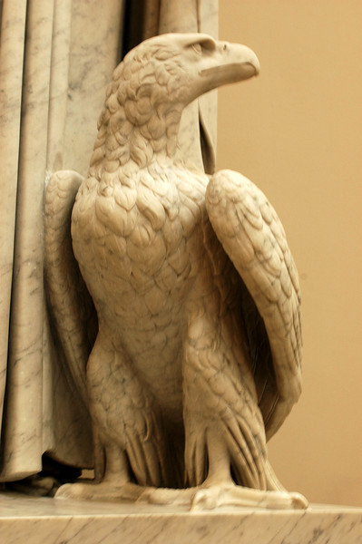 Eagle standing on a saint.