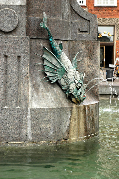 Spitting fish fountain in very popular square.