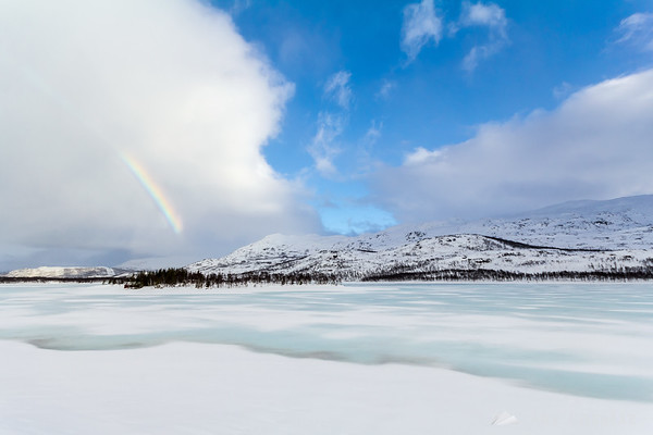 Frozen lake and a rainbow