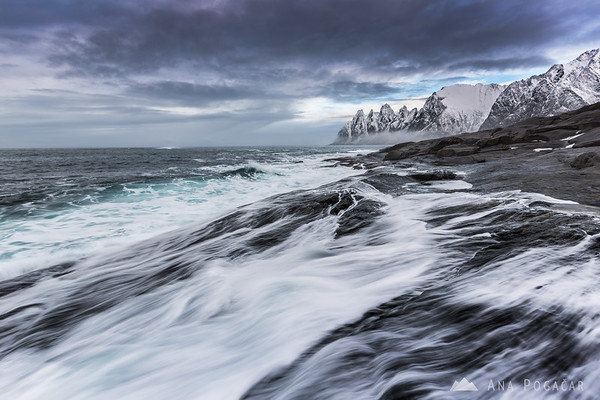 Waves crashing along the rugged coast of Senja Island