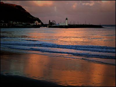 Luna Park and lighthouse at dusk