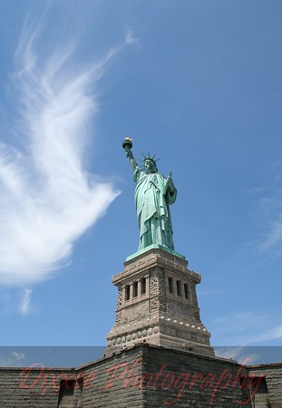 """A cloud """"Dove"""" flying in to greet Lady Liberty.  Sometime perfection is right before our eyes."""