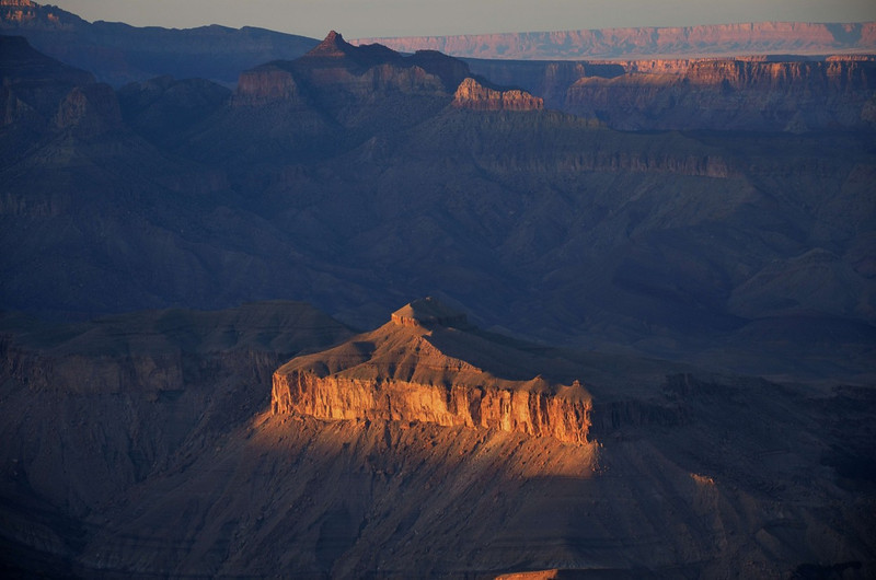 The last rays of sun illuminate below Lipan Point.<br />  Grand Canyon
