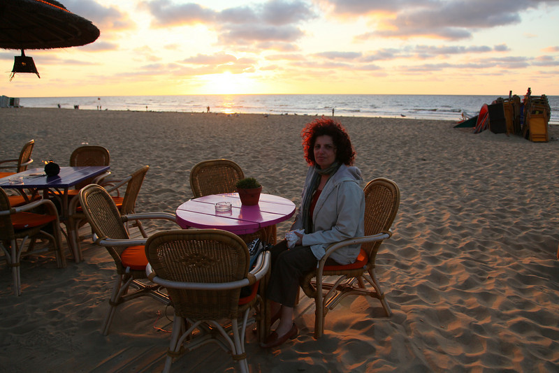 Banu (my wife) sitting on on of the many beach terraces.