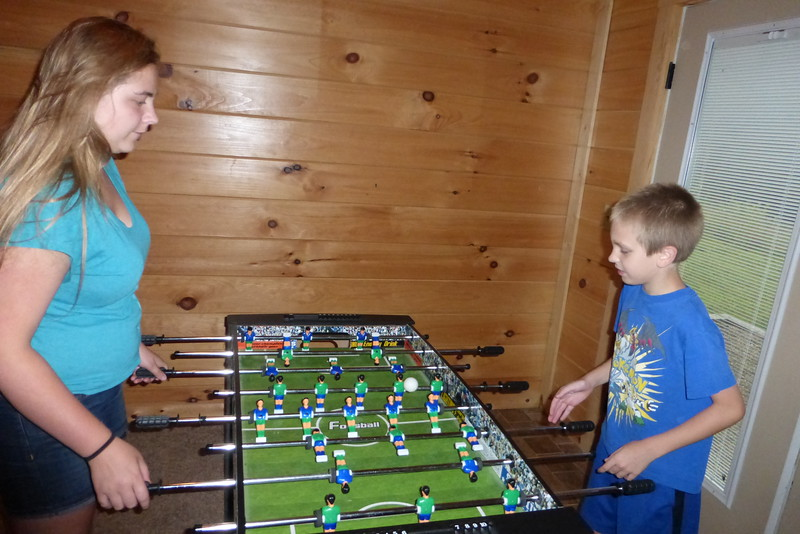 Katie and Matt playing foosball