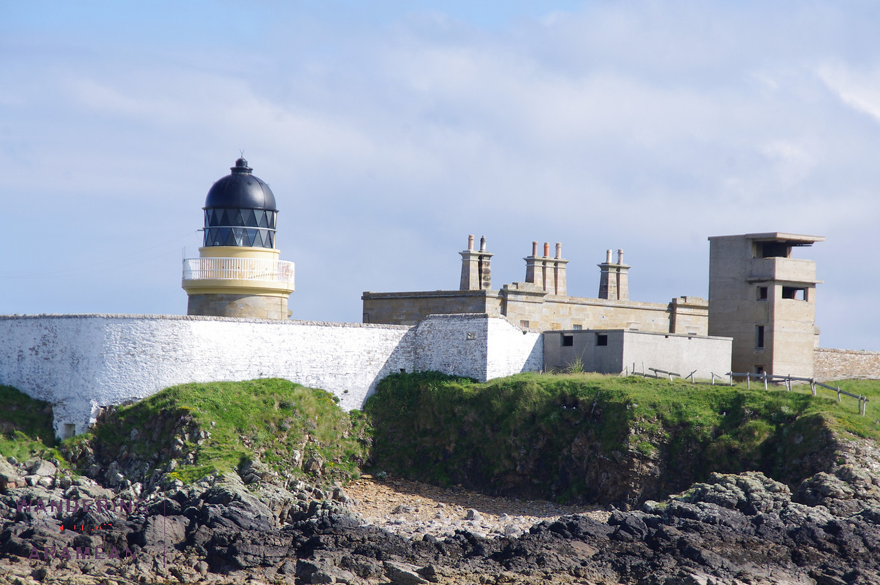 Lighthouse and bunkers on the shore guarding the Orkney Mainland