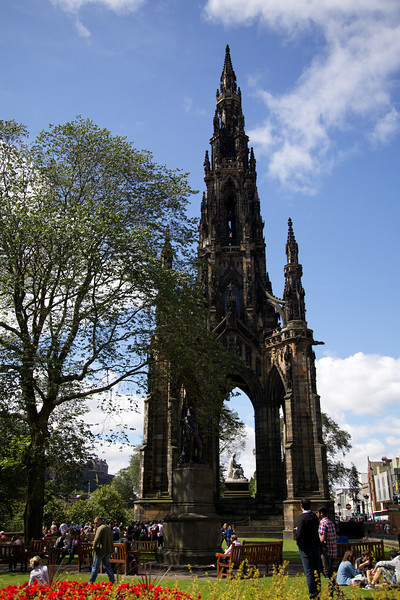 The Scott Monument is a Victorian Gothic monument to Scottish author Sir Walter Scott. It stands in Princes Street Gardens in Edinburgh, opposite the Jenners department store on Princes Street and near to Edinburgh Waverley Railway Station.<br /> <br /> The tower is 200 feet 6 inches (61.11 m) high, and has a series of viewing decks reached by a series of narrow spiral staircases giving panoramic views of central Edinburgh and its surroundings. The highest viewing deck is reached by a total of 287 steps (those who climb the steps can obtain a certificate commemorating the event). It is built from Binny sandstone quarried in nearby Ecclesmachan. This oily stone was known to attract dirt quickly and was probably a deliberate choice to allow the Gothic form to quickly obtain the patina of age.[citation needed] Arguably the soot of Edinburgh's chimneys, in combination with smoke from the nearby railway line and Waverley Station perhaps over-egged the result, and it is now very hard to make out the numerous carved figures.