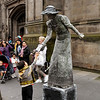 Edinburgh - there was a lot of interest in this unusual performer.  She leaned down several times and handed objects back and forth with the small boy.