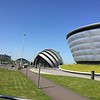 """The Armadillo"" on the left and another sports arena on the right in Glasgow. These are projects of rejuvenation build on the riverbank that was once busy with major shipbuilding enterprises."